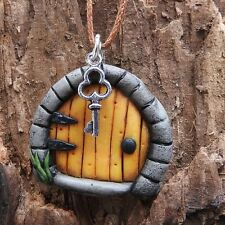 Hand made yellow fairy door pendant with tiny key on brown cord #fd7