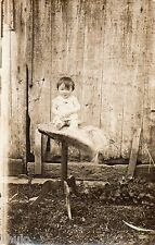 BJ199 Carte Photo vintage card RPPC Enfant portrait bébé sur table extérieur