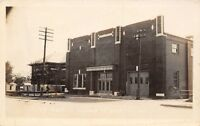 Colby KS~Man Takes Breather by Fire Station~City Hall~Carnegie Library~RPPC 1919