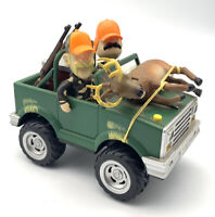 Gemmy Motion Activated Singing Deer on hood with Bobblehead Hunters in 4×4