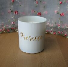 New in box, lovely Prosecco scented candle