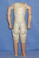 Lederkörper mit Holzarmen und Celluloidbeinen 29 cm/leather body w. arms of wood