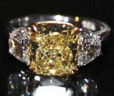 3 Stone GIA Certified 2.35 Carat Fancy Yellow Cushion Cut Diamond Ring Platinum