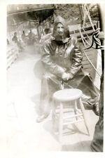 Old b/w photo man on deck in full rain gear ship boat fisherman? Niagara Falls?