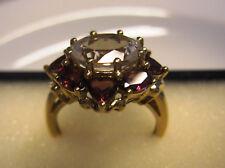 Echter 375 Gelbgold Ring , 9 Karat, Bergkristall im Ovalschliff und Granate.