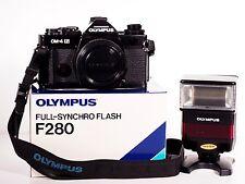 Olympus OM-System OM-4 Ti 35mm Spiegelreflexkamera (black) +Blitz F280