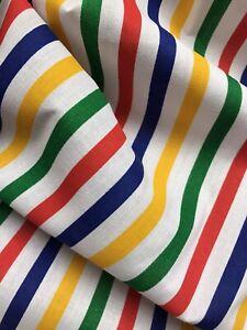 Red, blue, yellow, green medium stripe design polycotton dress/craft fabric