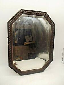VINTAGE MIRROR. 1930's Wooden Framed Bevelled mirror, hand carved