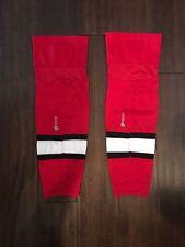 Firstar 27'' Intermediate/Junior Red & Black Hockey Socks. Carolina Hurricanes