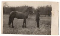 802420 VINTAGE RPPC REAL PHOTO POSTCARD MAN AND HORSE IN FIELD