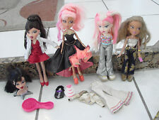 Bratz doll lot of 4 girls dolls dressed with styling head, pink hair X2 extras