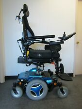 "PERMOBIL M300 WHEELCHAIR WITH POWER TILT, RECLINE,LEGS, 8"" SEAT  LIFT, LIGHTS."