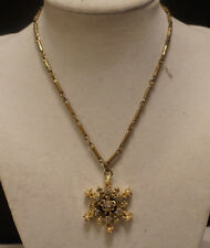 Vintage gold tone necklace with snowflake style rhinestone pendant, choker