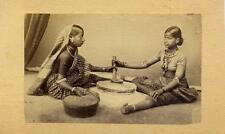 Two Women Grinding Grain. India.  Albumen Print