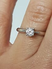 Solitaire Diamond Ring has been re-plated and clasps secured very good condition