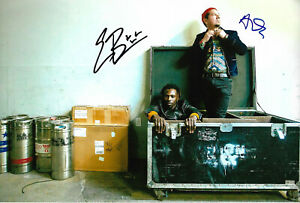 Black Pumas signed 8x12 inch photo autographs