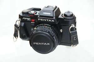 Pentax Program A with SMC Pentax-A  50mm f1.7 Lens and case.Mid 1980's