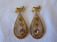 MONET CLIP-ON GOLDTONE DROP EARRINGS WITH COPPER COLORED RHINESTONES