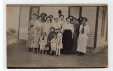 """Picture postcard of a family group - """"Eichman Clan"""" of Kansas (C32778)"""