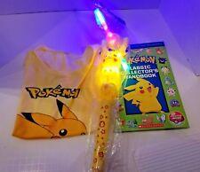 Pokemon Pikachu yellow Tshirt + Hand book & Rare Toy w lights sound movement +