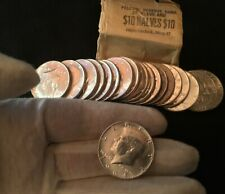 1964 Kennedy Half Dollar BU (one) Coin may have some toning