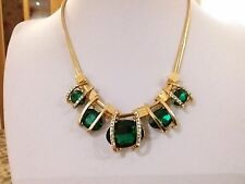 Brand new gold necklace with large emerald green  stones and gift box