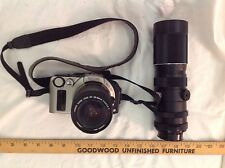 Canon EOS IX with  Canon zoom lens 28-80mm and Vivitar Tele-Zoom