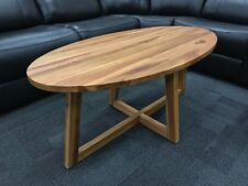 Hand Made Solid Teak Oval Coffee Table with Pedestal base and natural finish.