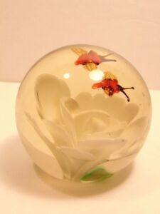 Older decorative glass paperweight with white flower & 2 bees
