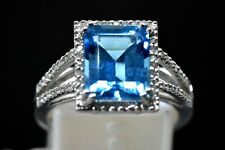 Emerald Cut Blue Topaz 3.87 Carat Ring With Diamond 0.17 ct. Halo 14K White Gold