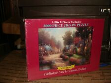 New 3000 piece A bits and pieces Cobblestone Lane by Thomas Kinkade New puzzle