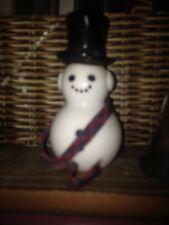 Avon Dapper Snowman Moonwind Cologne 1 Fl Oz with Cap on Bottle.