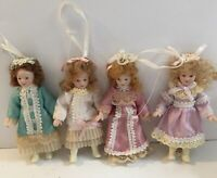 Vintage mini porcelain hanging dolls with dress & hair ribbons lot of 4. (H)