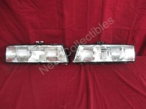NOS OEM Pontiac Bonneville Headlamp Light 1987 PAIR