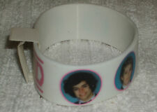RUBBER SILICON WRISTBANDS ** ONE DIRECTION ** NEW - 25 cm - COLOUR MAINLY WHITE