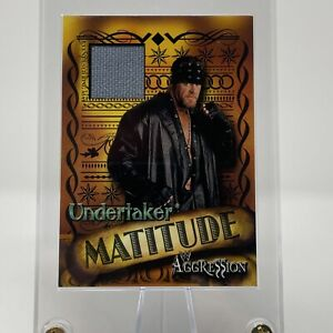 UNDERTAKER 2003 FLEER SKYBOX MATITUDE AGGRESSION EVENT USED RING MAT RELIC