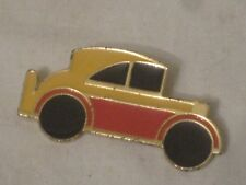vintage car pin yellow orange black metal enamel auto automobile vehicle brooch