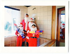 "Weird Xmas Card - ""Santa Family"" With Supersoaker Water Guns"