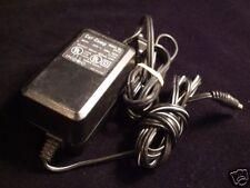 Cal-Comp Model No. R1613 30V 400mA negative tip Power Supply Ac Adapter