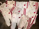 ONE (1) AUTHENTIC GAME WORN USED WISCONSIN BADGERS FOOTBALL PANTS (ASSORTED)