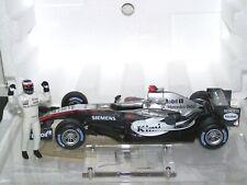 "1:18 Raikkonen McLaren MP4-20 ""Seasoncar 2005 incl. part of racingsuit"" OVP"