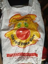 Red Nose Day collectables 2011, 1999, 1997 carrier bag and three noses