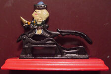 Vintage Cast Iron Soldier Nut Cracker Mounted on a Red Wood Base