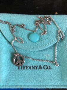 Tiffany & Co silver peace sign necklace, genuine comes with pouch