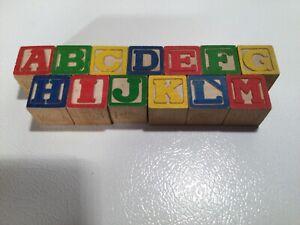 Set of 13 wooden alphabet blocks