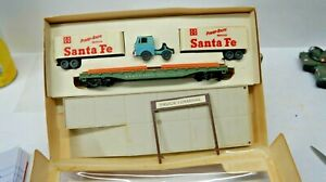 TYCO =  # 9926-900  LOG  DUMP  FLAT  CAR  SET   BOXED