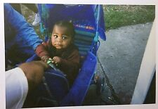 vintage PHOTO Small Child Unhappy in Blue Stroller Holding Tightly onto Toy