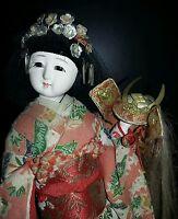 Vintage Japanese Geisha holding Samurai Helmet  Doll