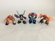 LOT OF 4 TRANSFORMERS MINI FIGURES. OPTIMUS PRIME