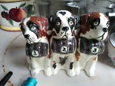 three st. Bernard rescue dogs, ceramic, all molded together